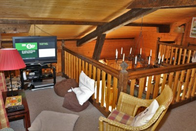 The TV area on the mezzanine floor above the living room